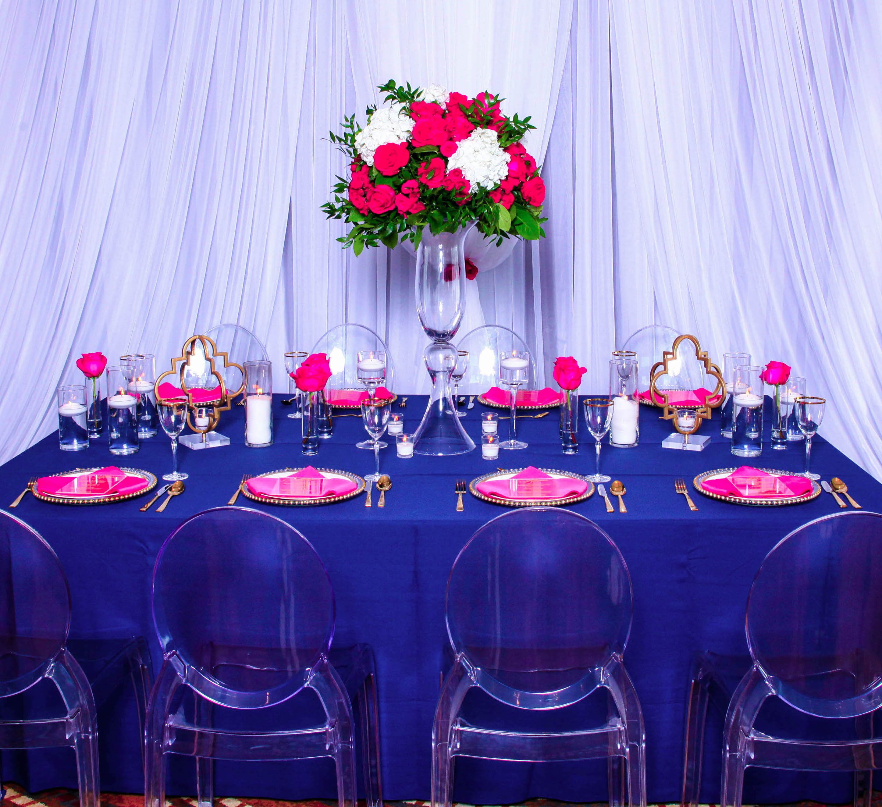 tall centerpiece with ghost chairs