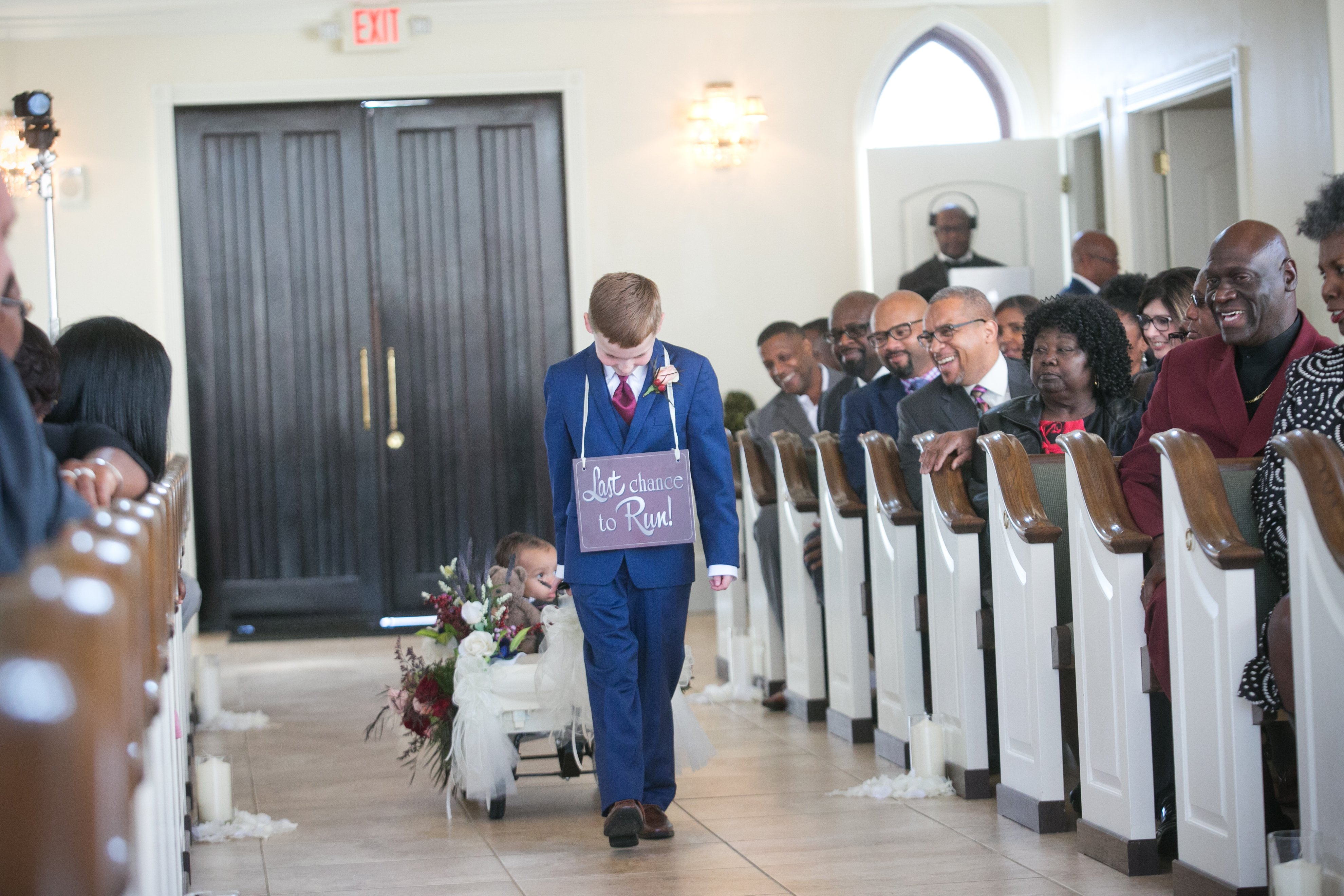Ring Bearer with a Sign | LeeHenry Events
