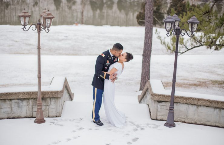Kissing in the snow wedding picture